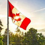 Canada flag waving above UBC Rose Garden